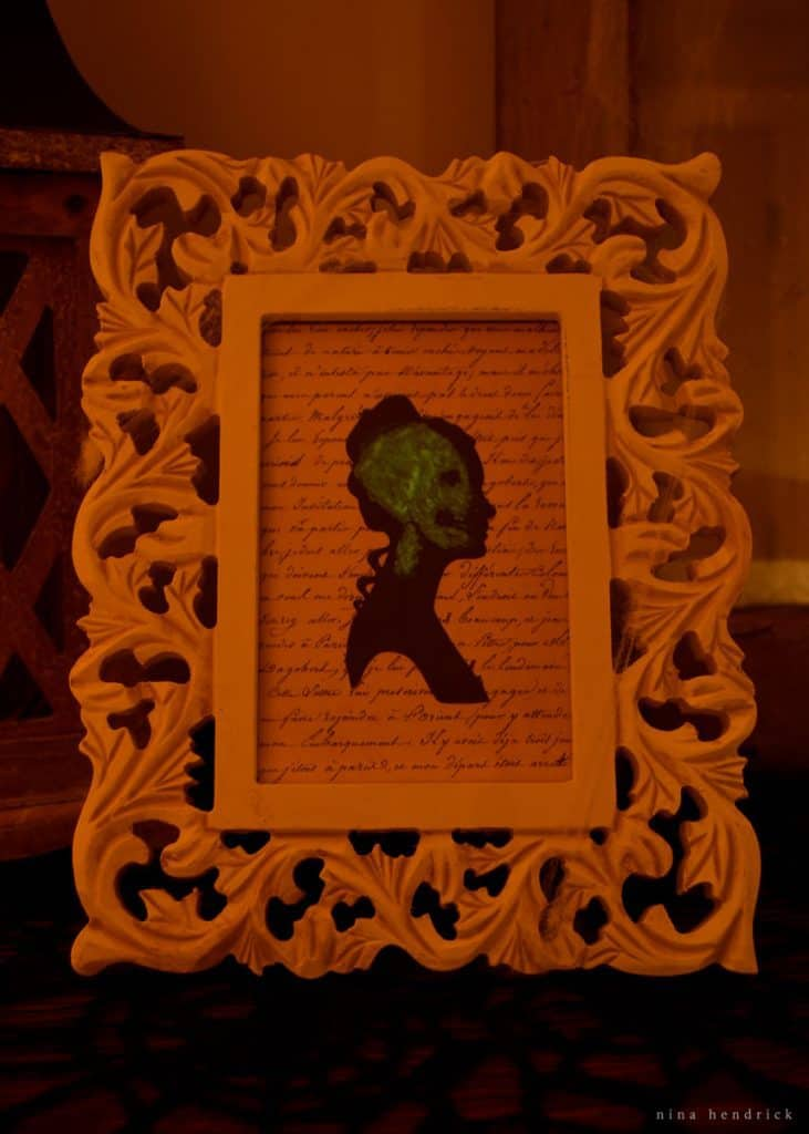 Learn how to create a surprise spooky cameo using glow-in-the-dark Mod Podge. Once the lights go out, a creepy green skull appears...