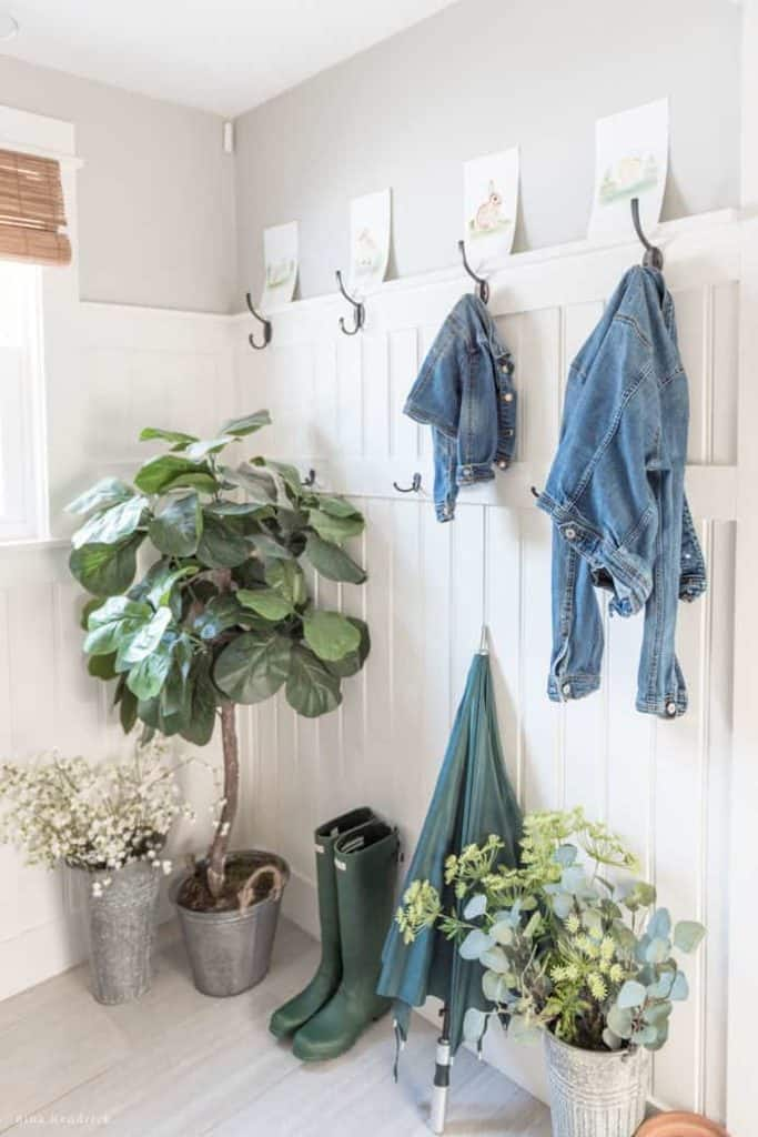 Spring Mudroom Decor | This mudroom with beadboard walls is decorated for Spring with rainboots, an umbrella, and a fiddle leaf fig.