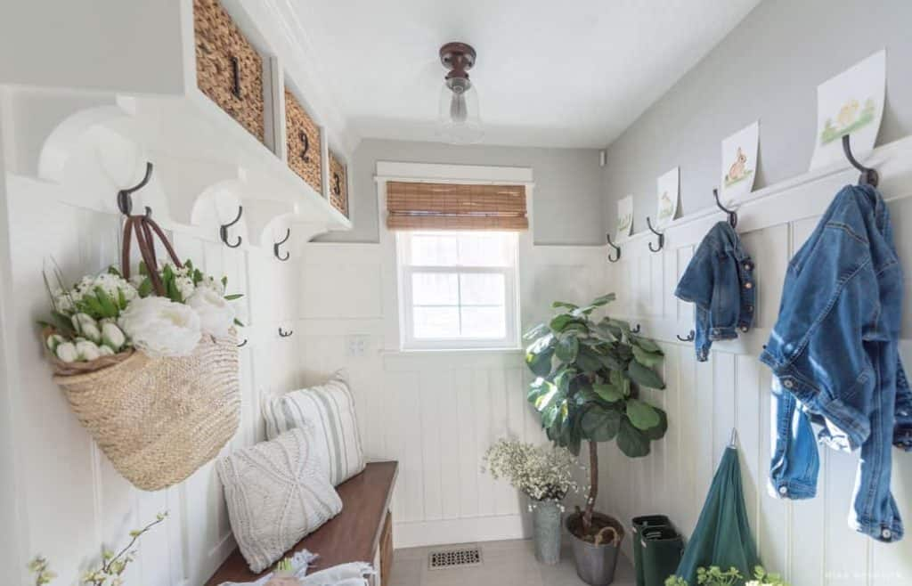 Spring Mudroom Decor | This New England-style mudroom with built-ins and beadboard walls is decorated for spring with flowers.