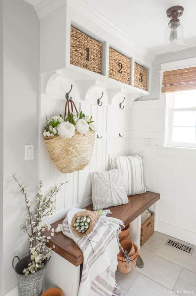 Spring Mudroom Decor | These DIY mudroom built-ins are decorated for Spring with a market basket and fresh flowers.