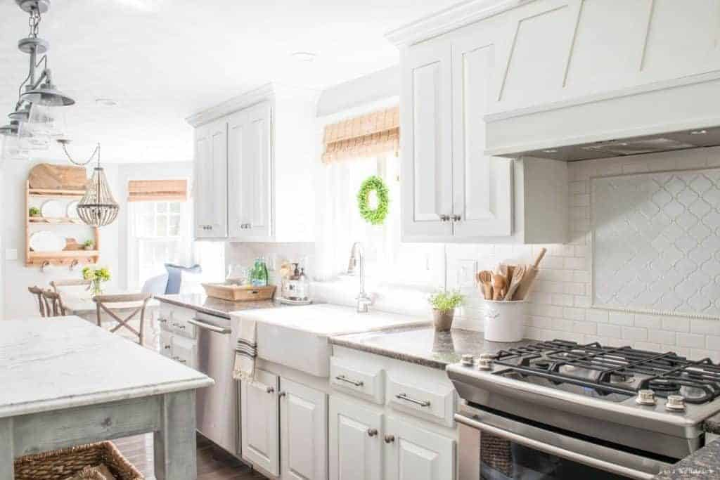 Sunny kitchen with white painted oak cabinets