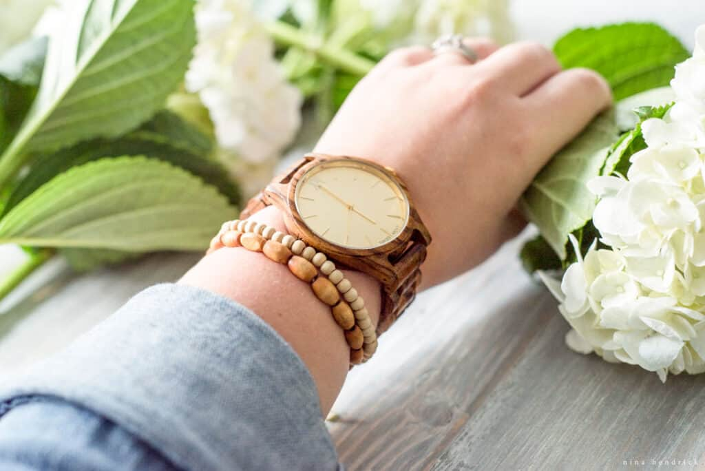 arm with watch and flower