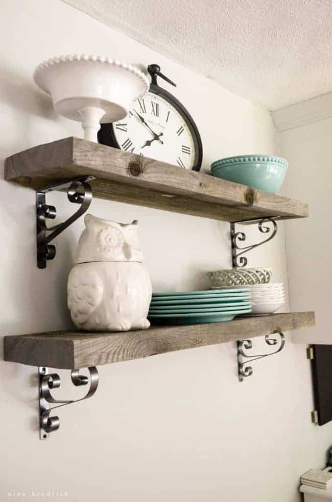 These rustic rough cut weathered pine kitchen shelves are a quick and simple DIY project that makes a huge impact.
