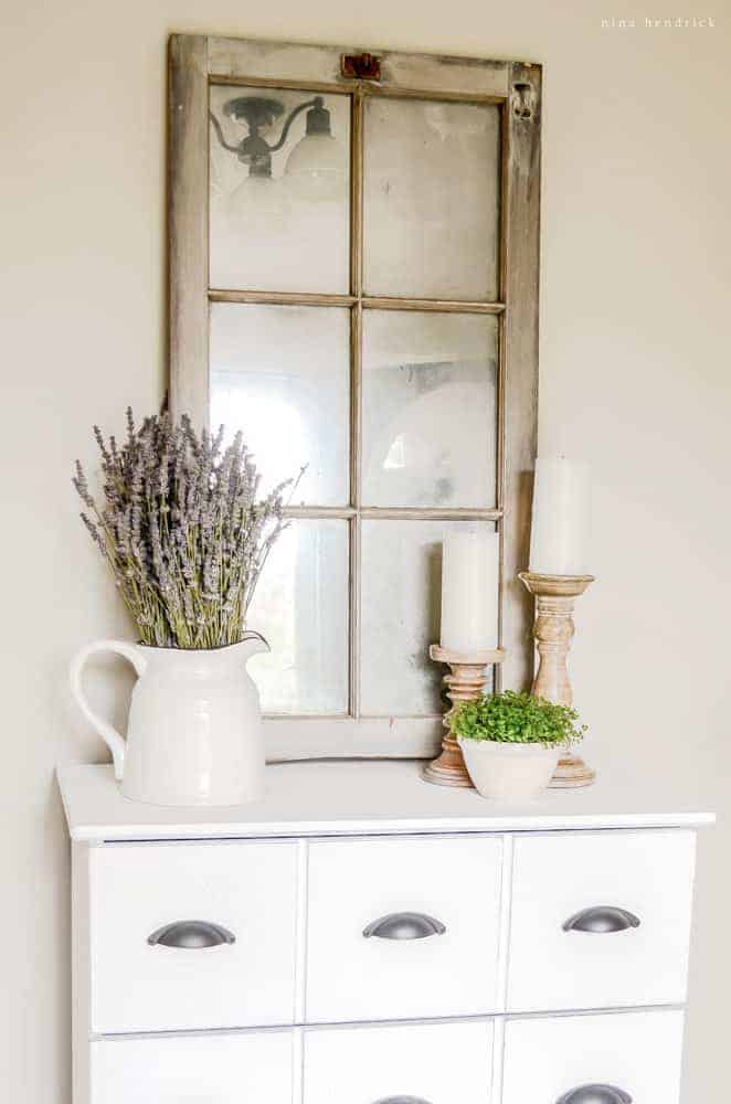 Learn how to transform a barn window to an antique mirror using looking glass spray paint. This is a great idea for all of those old windows I have!