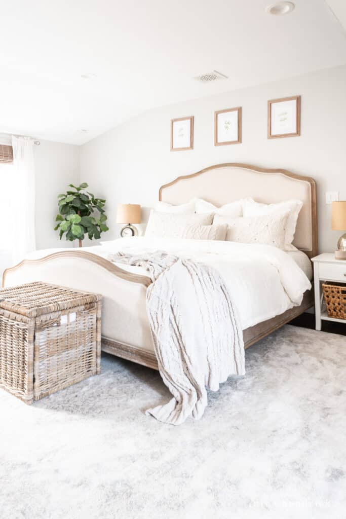 Wood and Upholstered Bed with neutral bedding in a Repose Gray bedroom