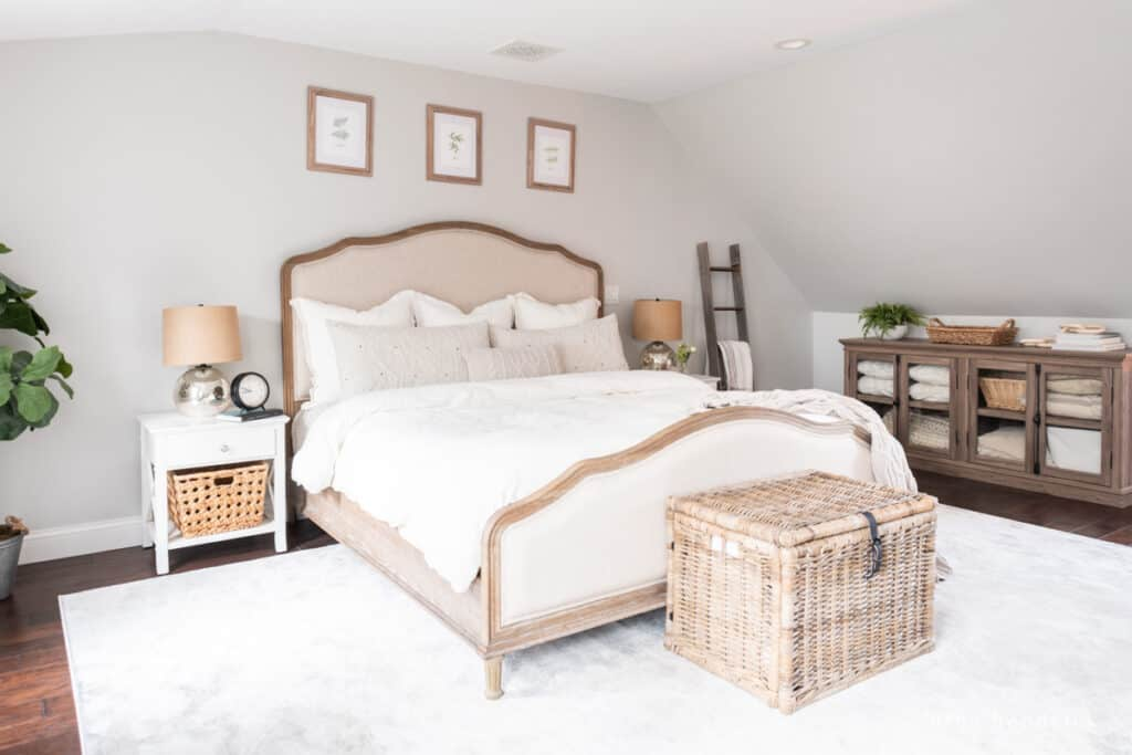 Neutral Bedroom with cream rug and wicker baskets