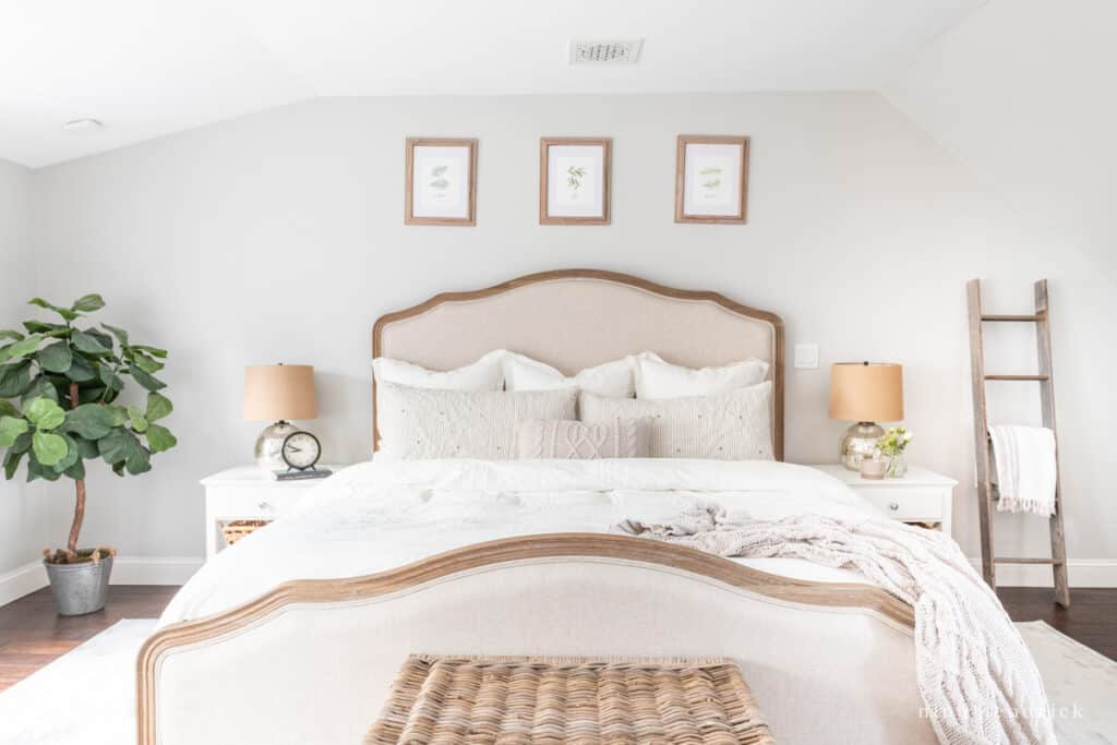 Bedroom with Respose Gray walls and cream bedding